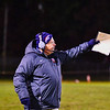 North Middlesex head coach Sandy Ruggles points towards the field during Friday night's loss to Quabbin. Nashoba Valley Voice/Ed Niser