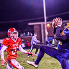 North Middlesex defensive back Xavier Marty watches as Quabbin wide receiver Collin Sweeney hauls in a pass. Nashoba Valley Voice/Ed Niser