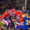 North Middlesex quarterback Joe Haskins is stripped of the ball during Friday night's loss to Quabbin. Nashoba Valley Voice/Ed Niser