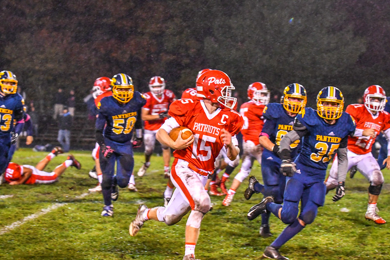 North Middlesex's Joe Haskins takes off down the sideline in the second half of Friday night's loss to Quabbin. Nashoba Valley Voice/Ed Niser