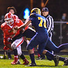 North Middlesex's Dan DIPano runs through contact during Friday night's loss to Quabbin. Nashoba Valley Voice/Ed Niser