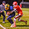 North Middlesex's Xavier Marty runs Quabbin's Collin Sweeney out of bounds. Nashoba Valley Voice/Ed Niser