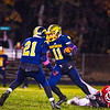Quabbin's Colby Smith slips away from North Middlesex's Jake Hachey. Nashoba Valley Voice/Ed Niser