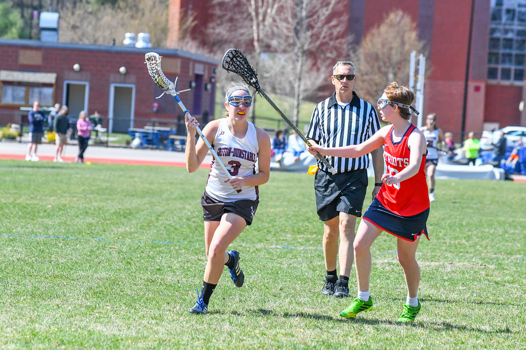 . Groton-Dunstable\'s Avery Dichter is defended by North Middlesex\'s Emma Kinney. Nashoba Valley Voice/Ed NIser
