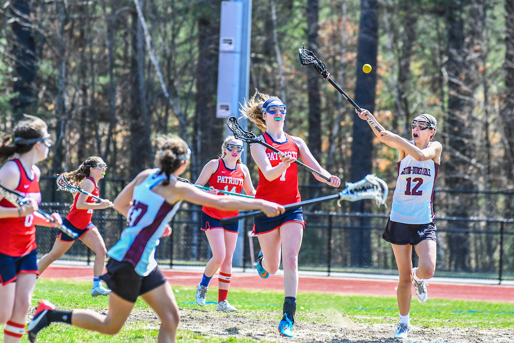 . North Middlesex\'s Maddie Harrington and Groton-Dunstable\'s Ellie Eisenklam in action. Sentinel & Enterprise/Ed Niser