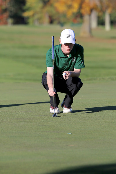 Nashoba junior Cam Roberts looks over the green before making a putt during the match on Tuesday afternoon at Oak Hill Country Club in Fitchburg. SUN/JOHN LOVE