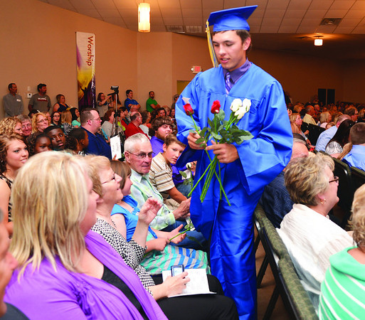 Kade Taylor, during the rose ceremony at the Central High graduation, looks for family members and friends to present them with a flower and a hug. The rose ceremony preceded the presentation  of diplomas.