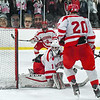 Hudson's goaltender Adam Devlin reacts as he watches Keegan Penney's (G-D, not pictured)  first-period goal slip past him. Nashoba Valley Voice/Ed Niser