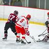 Groton-Dunstable goaltender Ben McEvoy makes a save on Hudson's Cam O'Brien. Nashoba Valley Voice/Ed Niser