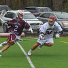 Groton-Dunstable's Nate Townsend drives against Algonquin's Ryan Lesekvae. Nashoba Valley Voice/Ed Niser