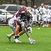 Groton-Dunstable's Jack O'Neill battles for a ground ball. Nashoba Valley Voice/Ed Niser