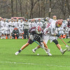 Groton-Dunstable's Jack O'Neill chcks an Algonquin player as they battle for a ground ball. Nashoba Valley Voice/Ed Niser