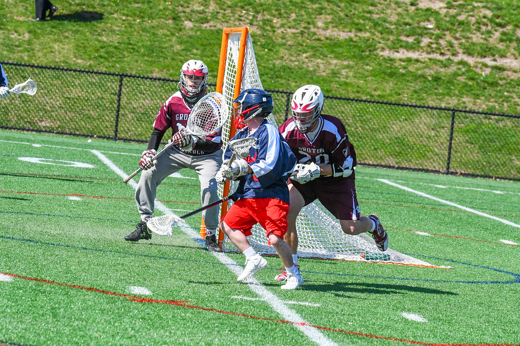 . North MIddlesex\'s Peter Polito looks to make a shot as he is defended by Groton-Dunstable\'s Drew Bernard. Nashoba Valley Voice/Ed Niser