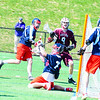 Groton-Dunstable's Michael Tammaro has his shot stopped by North Middlesex goalie Jake Baron. Nashoba Valley Voice/Ed Niser