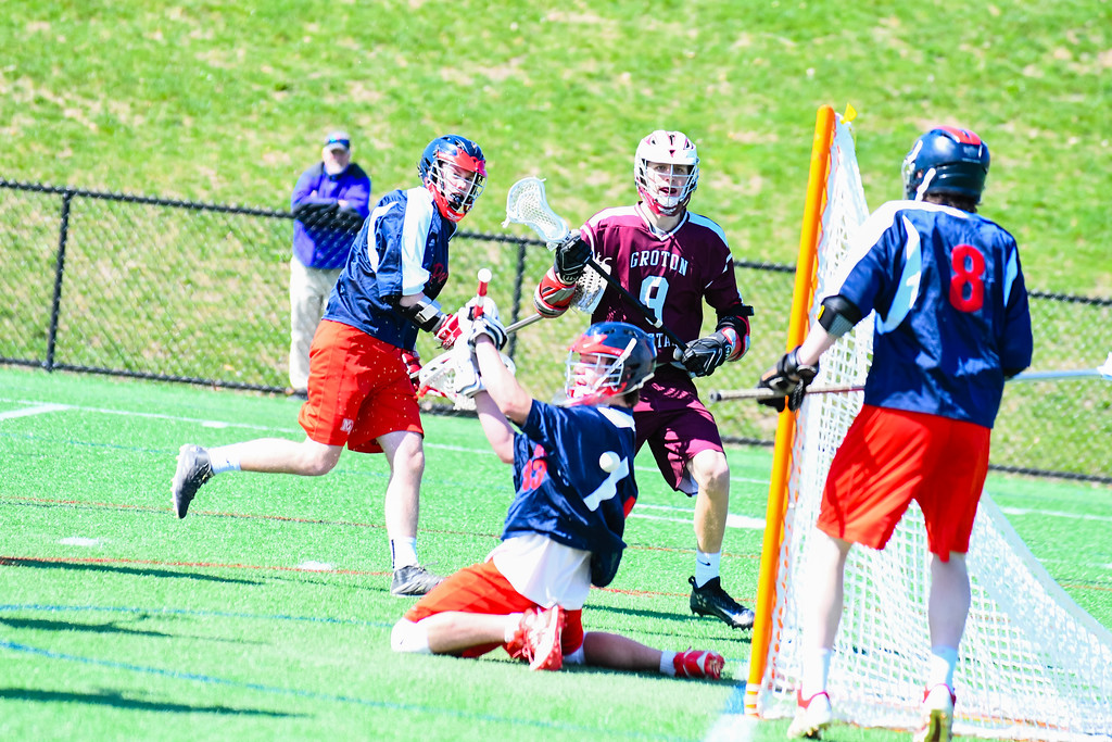 . Groton-Dunstable\'s Michael Tammaro has his shot stopped by North Middlesex goalie Jake Baron. Nashoba Valley Voice/Ed Niser
