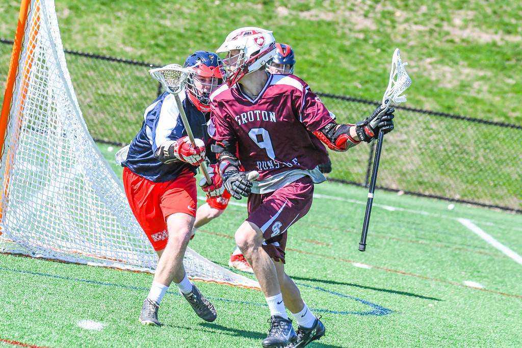 . Groton-Dunstable\'s Michael Tammaro is defended by North Middlesex\'s Gavin Donohoe. Nashoba Valley Voice/Ed Niser