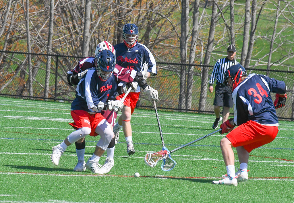 . Groton-Dunstable and North Middlesex players scramble for a ground ball during Tuesday morning\'s game. Nashoba Valley Voice/Ed Niser