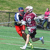 Groton-Dunstable's Blake Lacombe is defended by North Middlesex's Jake Fitzgerald. Nashoba Valley Voice/Ed Niser