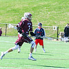 Groton-Dunstable longstick midfielder Nathaniel Forbes carries the ball up the field. Nashoba Valley Voice/Ed Niser