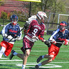 Groton-Dunstable's Michael Tammaro is double-teamed by North Middlesex's Tim O'Neill and Gavin Donohoe. Nashoba Valley Voice/Ed Niser