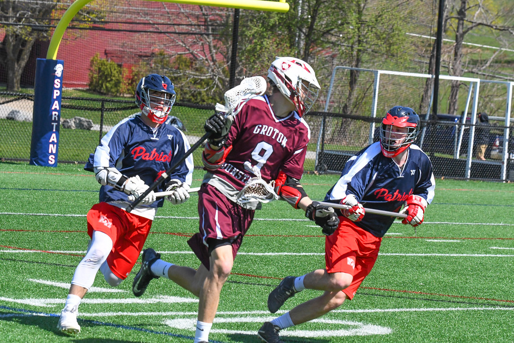 . Groton-Dunstable\'s Michael Tammaro is double-teamed by North Middlesex\'s Tim O\'Neill and Gavin Donohoe. Nashoba Valley Voice/Ed Niser