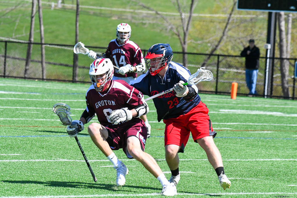 . Groton-Dunstable\'s Cam Battles weathers a check from North Middlesex\'s Eric Murphy. Nashoba Valley Voice/Ed Niser