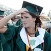 Madison Barr holds onto her cap before the graduation ceremonies last Thursday evening at Dragon Stadium.