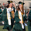 Salutatorian Caitlin Edmunds and Valedictorian Carla Upperman march into Dragon Stadium at the start of graduation ceremonies last Thursday evening.