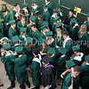 Carroll seniors assemble in preparation for the graduation ceremony at Dragon Stadium last Thursday evening.