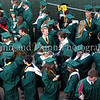 Carroll seniors assemble in preparation for the graduation ceremonies last Thursday evening at Dragon Stadium .