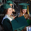 Salutatorian Caitlin Edmunds and Valedictorian Carla Upperman wait for the start of graduation ceremonies last Thursday evening at Dragon Stadium.