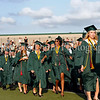 Carroll seniors march into Dragon Stadium at the beginning of the graduation ceremonies last Thursday evening.