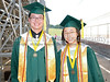 Salutatorian Eric Wang and Valedictorian Kathy Lee wait to enter the stadium prior to the start of the 2009 Carroll Senior High School Commencement ceremony last Friday afternoon at Dragon Stadium.*
