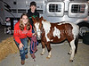 "**Madison Bowls and Grady Bruton show off ""Tucker"" at the 4H Club booth at Carroll's Homecoming Carnival last Wednesday night at Dragon Stadium."