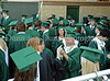 Carroll graduates wait for the  wait for the start of the 2011 Commencement ceremonies at Dragon Stadium.