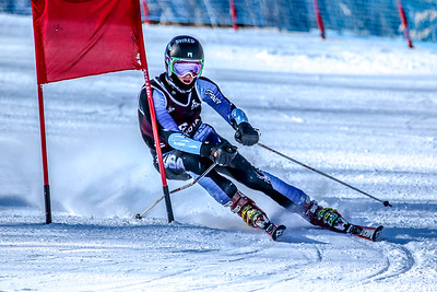 Oxford Hills' Chris Burns makes a turn at the top of the course during his first run in the giant slalom event at the class A state alpine championships at Mt. Abram in Locke Mills.  Burns finished second in the event.