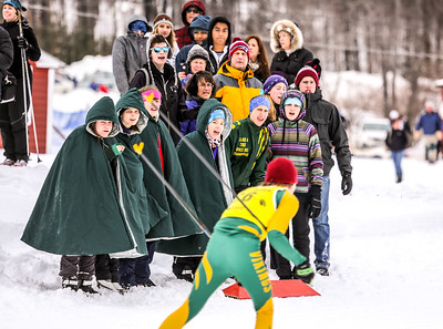 Ben Andrews' Oxford Hills teammates cheer him on as he approches the finish of the freestyle KVAC championships at Titcomb Mountain in Farmington.