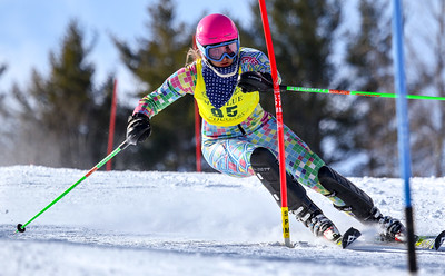 Brooke Lever of Edward Little executes a cross-block on a left-fotted turn as she skis her way to a second-plave finish in the KVAC slalom championships.