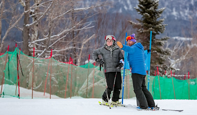 CVA coach Kevin Eccles gives some advice to Rylee McCormack before the woman's super G event.