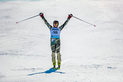 Tucker Marshall celebrates temporarily moving into podium position after crossing the finish line.