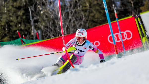 Third place finisher Lila Lapanja keeps her eyes forward as she traverses the headwall early in the race.