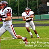 QO Fullback #35 Ben Brown and Linebacker #3 Marcus Newby warm up
