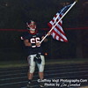 Offensive Lineman #66 Scott Mongold carries the flag brought back from Afghanistan by L Cpl Taylor Lemmon