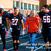 QO seniors #4 Manuel Brown, #27 Keano Wilder, and #56 Derek Compton walk with their favorite teacher