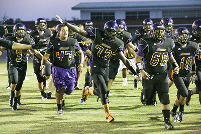 Gerald Atwater #73 and Andy Ixcajo #66 lead the pre-kickoff charge