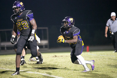 Trai Sharp #20 follows lead block by Damin Currie #52
