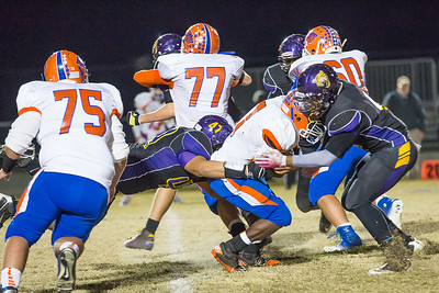 Luis Funes (#47) and Tobias Sales combine for tackle