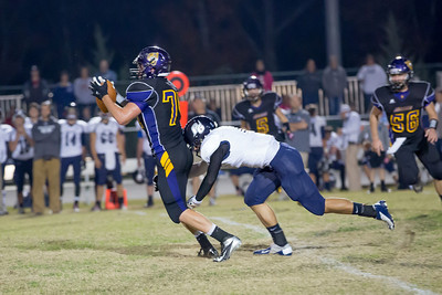 Linebacker Scott Peretin #74 intercepts pass in first half