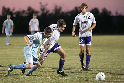 Vic Sullivan #18 battles for possession as Alican Arcosoi #12 closes.