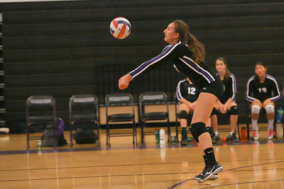 CHS Marie Samek #10 serves up ball on defensive rotation